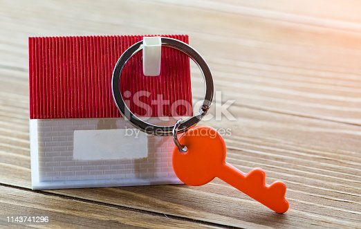 845342284 istock photo House Key And Key chain On Wooden Table 1143741296