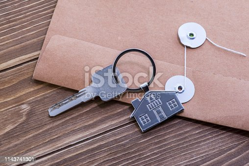 845342284 istock photo House Key And Key chain On Wooden Table 1143741301
