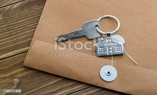 845342284 istock photo House Key And Key chain On Wooden Table 1143741309