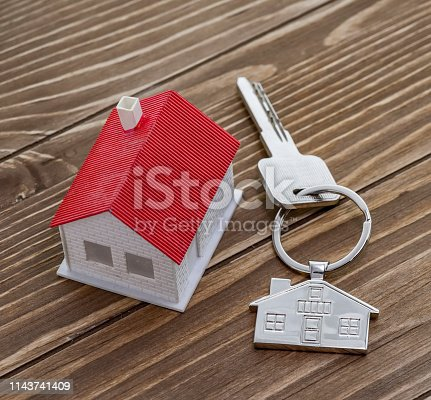845342284 istock photo House Key And Key chain On Wooden Table 1143741409