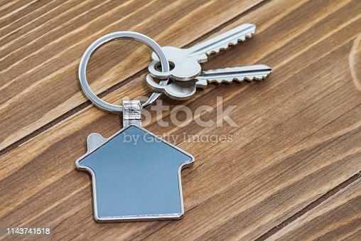 845342284 istock photo House Key And Key chain On Wooden Table 1143741518