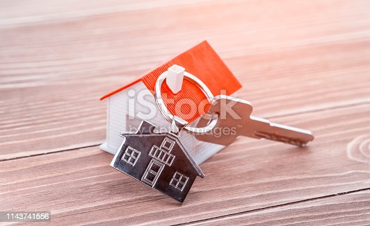 845342284 istock photo House Key And Key chain On Wooden Table 1143741556