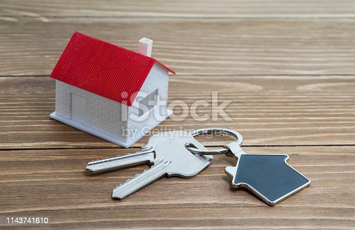 845342284 istock photo House Key And Key chain On Wooden Table 1143741610