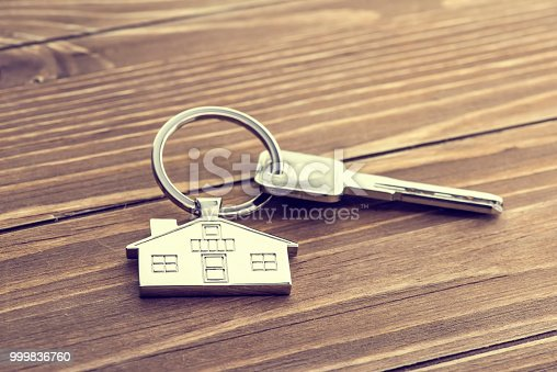 istock House Key And Key chain On Wooden Table 999836760