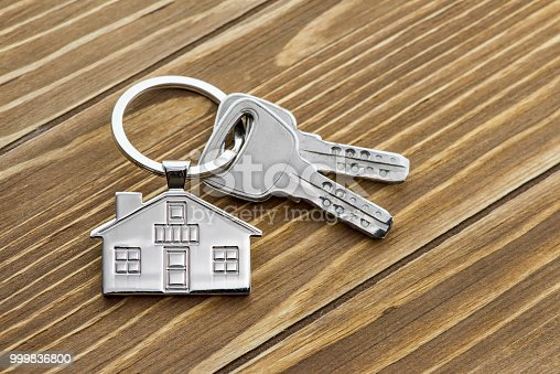 istock House Key And Key chain On Wooden Table 999836800