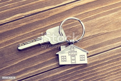 istock House Key And Key chain On Wooden Table 999836828