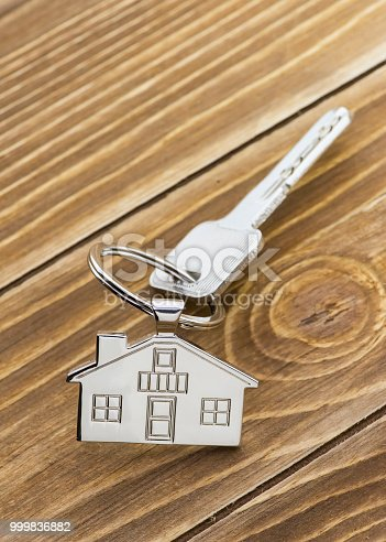 istock House Key And Key chain On Wooden Table 999836882