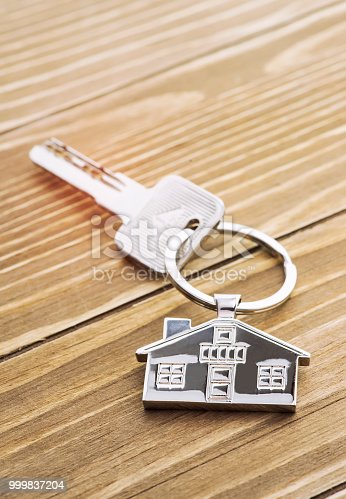 istock House Key And Key chain On Wooden Table 999837204