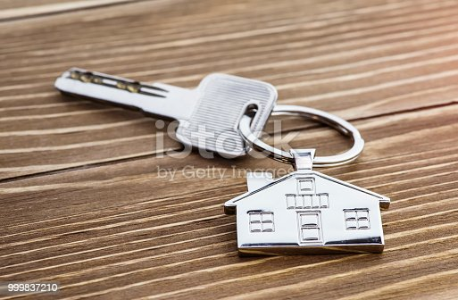 istock House Key And Key chain On Wooden Table 999837210