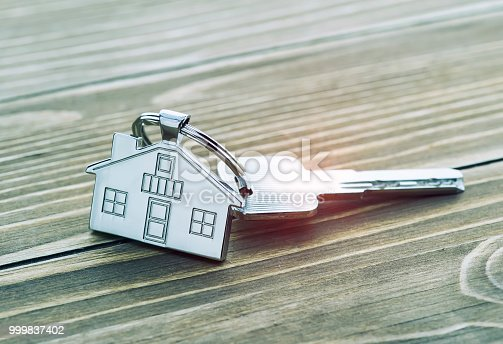 istock House Key And Key chain On Wooden Table 999837402
