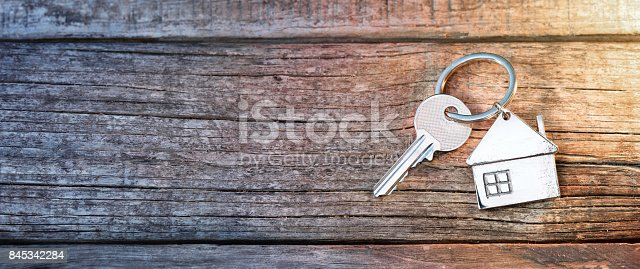 istock House Key And Keychain On Wooden Table 845342284