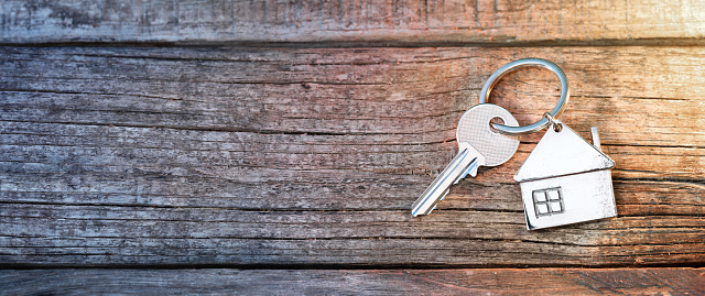 House Key And Keychain On Wooden Table Stock Photo - Download Image Now
