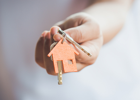 istock House key in hand 821895542