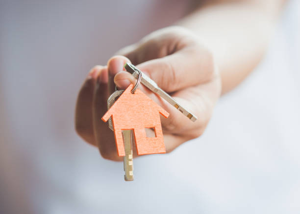 house key in hand - key stock pictures, royalty-free photos & images