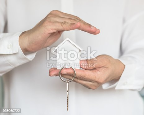 istock House key in home insurance broker agent's hand protection or in salesman person giving to buyer customer 958060722