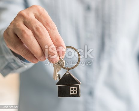 istock House key in real estate sale person, landlord or home Insurance broker agent's hand giving to buyer customer for new family property assurance concept 978724382