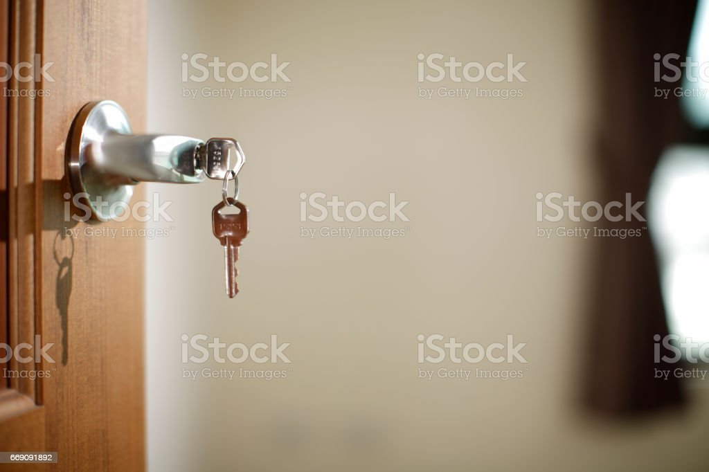 House key in the lock of a door stock photo