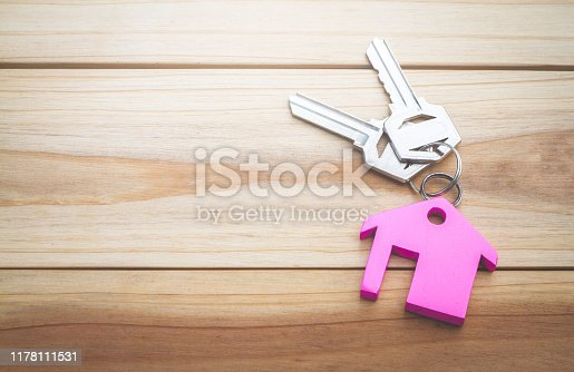 istock House key on a house shaped keychain concept, moving home or renting property, 1178111531