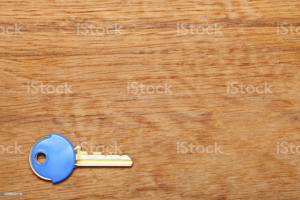 House key with blue plastic coats caps on table stock photo