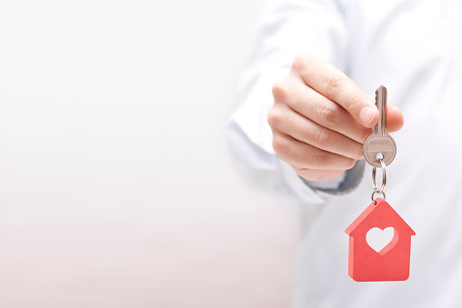 istock House key with heart in hand 820859026