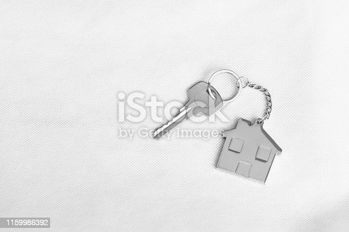 1135927471 istock photo House key with home keyring in on white background, copy space 1159986392