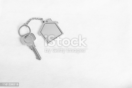 1135927471 istock photo House key with home keyring in on white background, real estate concept, copy space 1161336319