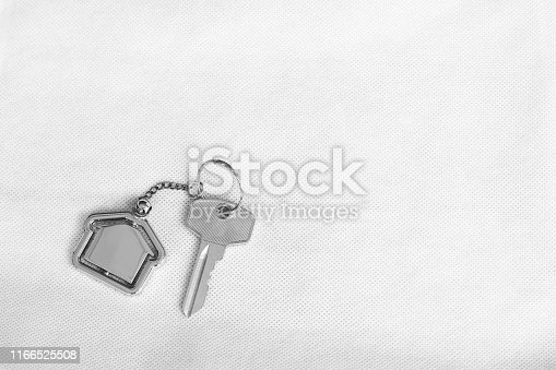 1135927471 istock photo House key with home keyring in on white background, real estate concept, copy space 1166525508