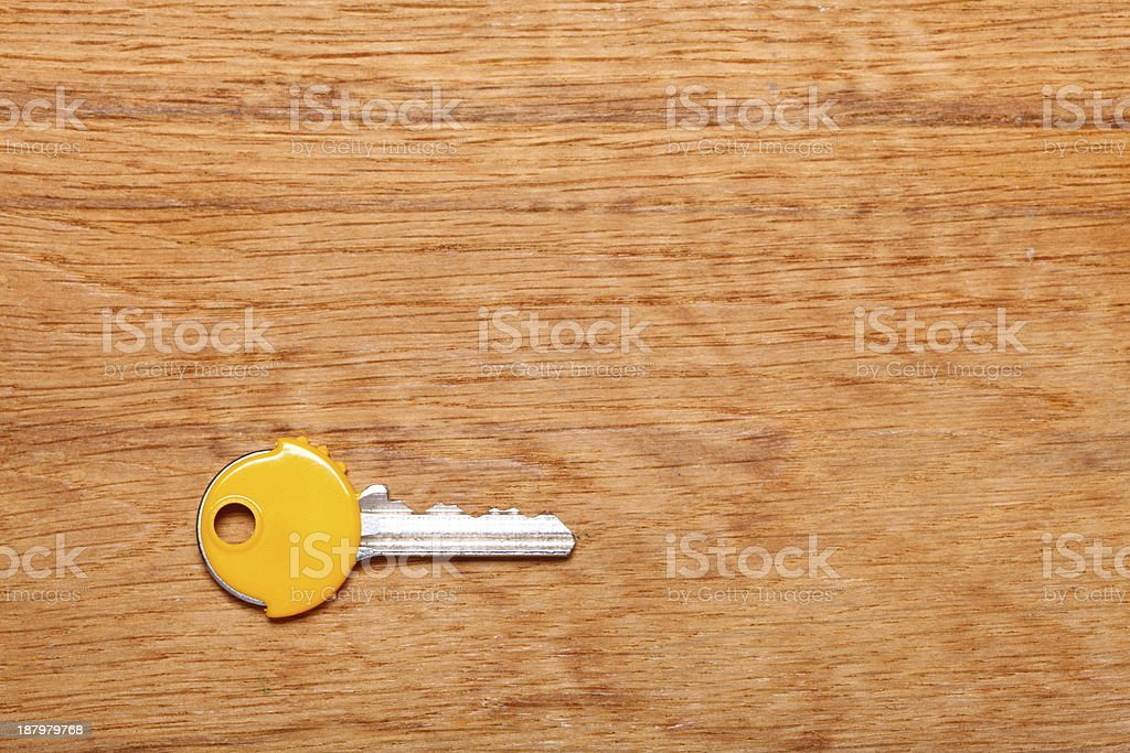 House key with yellow plastic coats caps on table stock photo