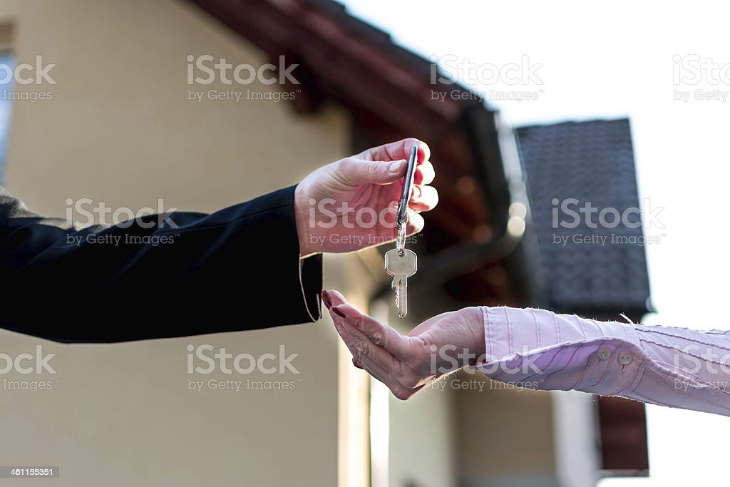 House keys being given to new owner royalty-free stock photo