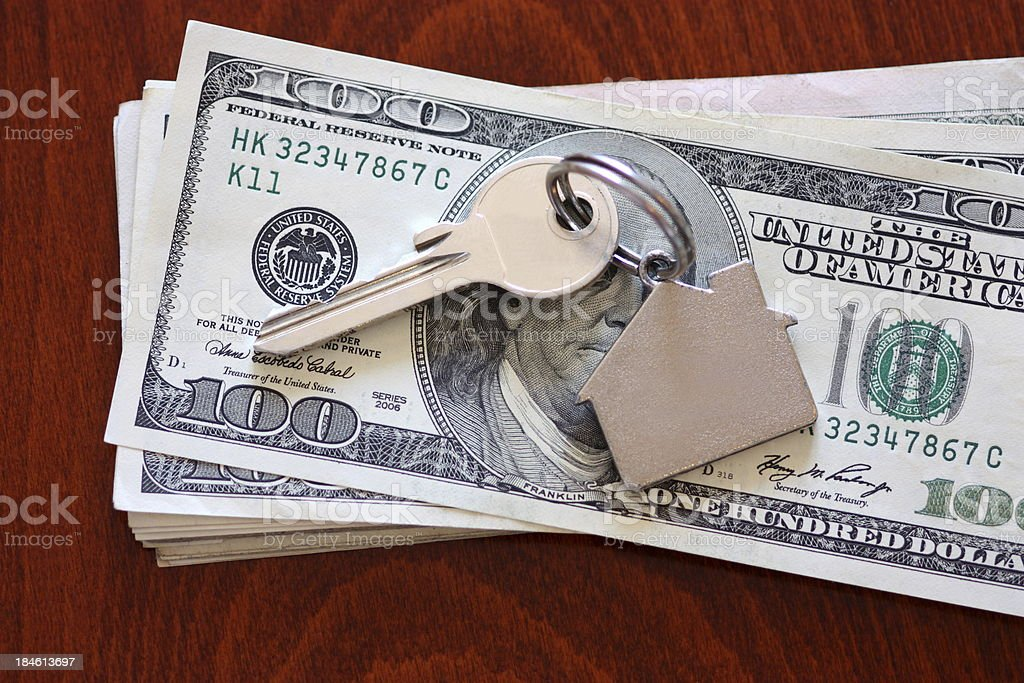 House keys on dollar royalty-free stock photo