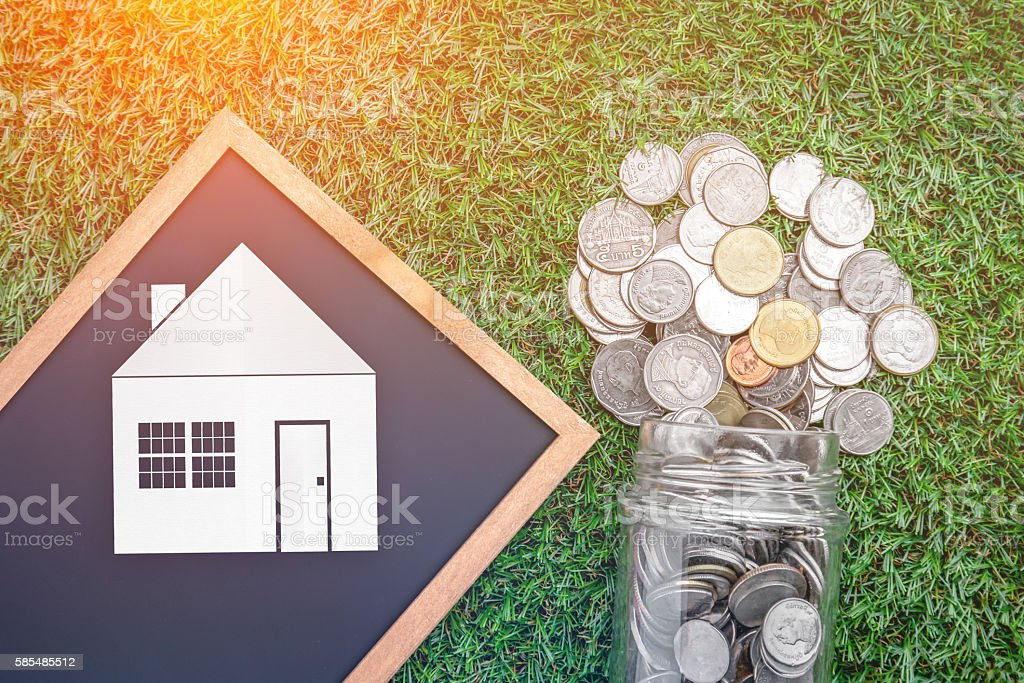 house loan business concept with coin fall from glass jar stock photo