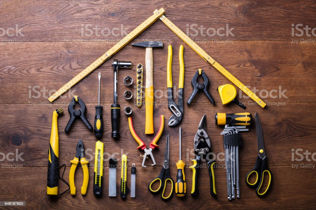 House Made Up Of Measuring Tapes And Tools stock photo