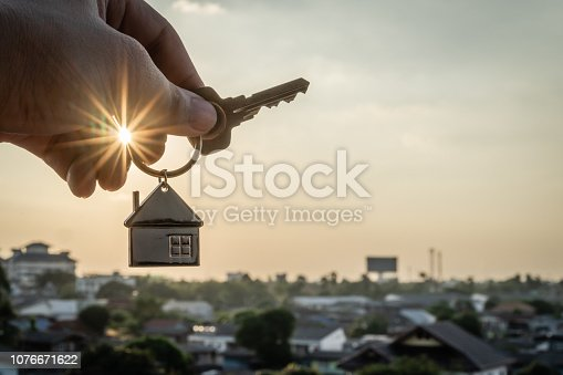 1164727388 istock photo House model and key in home insurance broker agent  hand or in salesman person. Real estate agent offer house, property insurance and security, affordable housing concepts 1076671622