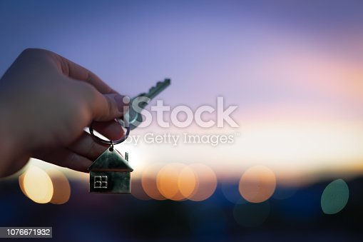 1164727388 istock photo House model and key in home insurance broker agent  hand or in salesman person. Real estate agent offer house, property insurance and security, affordable housing concepts 1076671932