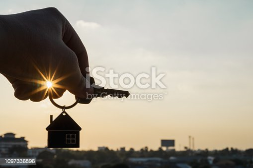 1164727388 istock photo House model and key in home insurance broker agent