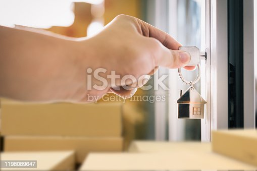 684793898 istock photo House model and key in house door. Real estate agent offer house, property insurance and security, affordable housing concepts 1198089647