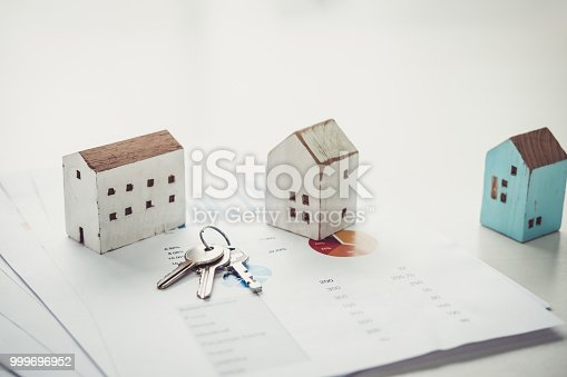 istock House model and key on table for finance and banking concept.Home purchase mortgage concept. 999696952