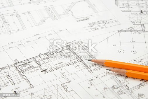 Real estate images, house model and pencils on blueprint