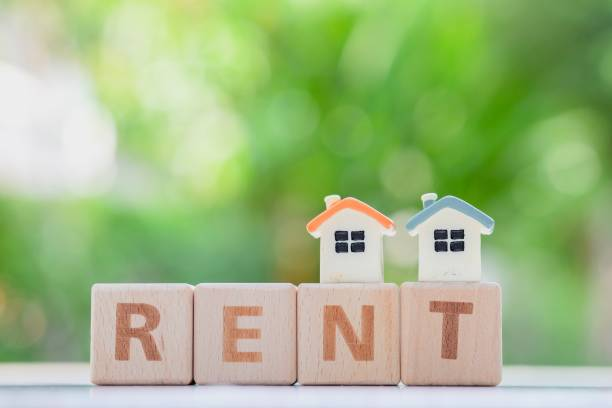 House model and wooden word RENT. Mini house model and wooden word RENT. renting stock pictures, royalty-free photos & images