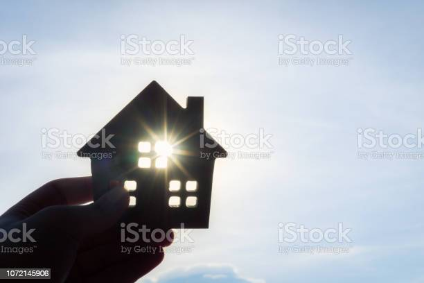 House model in home insurance broker agent u2018s hand or in salesman picture id1072145906?b=1&k=6&m=1072145906&s=612x612&h=ih9zgkattrs06c3lgykgrwa74b  kp nymswyrfu4sm=