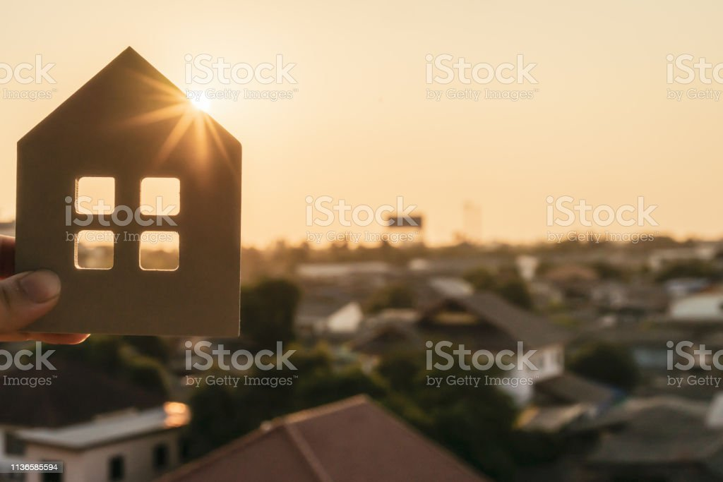 House model in home insurance broker hand or in salesman person. Real estate agent offer house, property insurance and security, affordable housing concepts stock photo