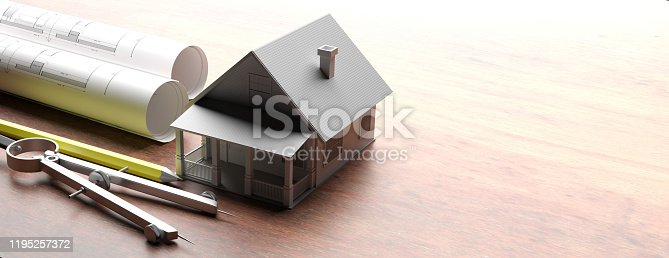 istock House model on blueprints background, engineer contractor office. 3d illustration 1195257372