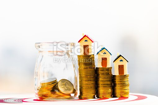 istock House model on coins stack. planning savings money of coins to buy a home concept. 1143950844