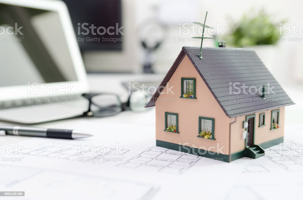 House model on desk, mortgage or house building concept royalty-free stock photo