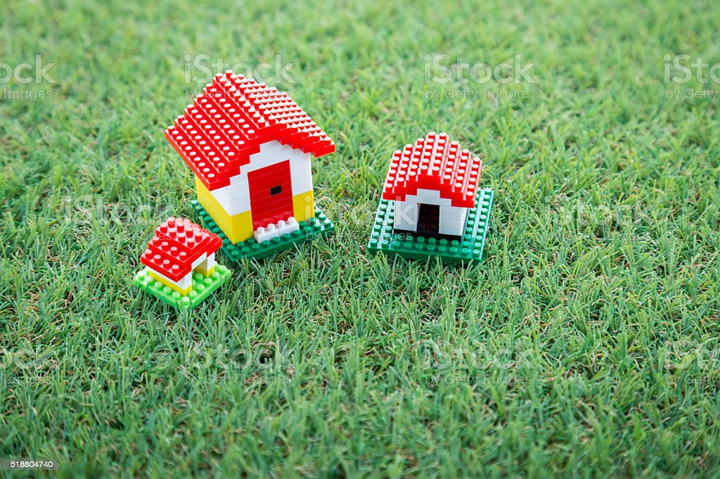 house model on green grass field stock photo