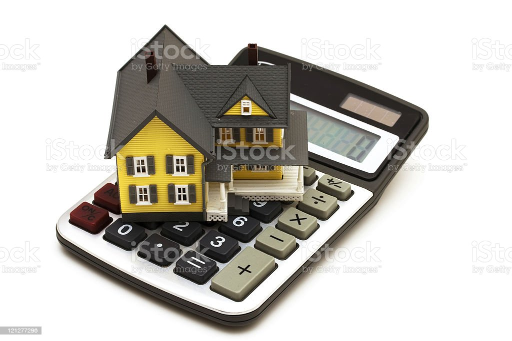 House model sitting on a calculator symbolising mortgage stock photo