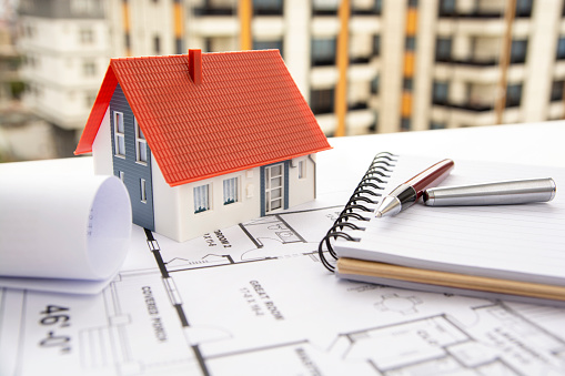 House model with blueprint sample and pen stock photo