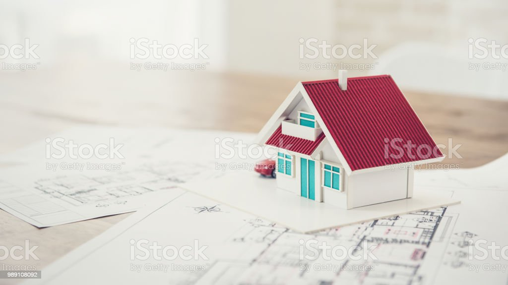 House model with blueprint sample for real estate development stock photo