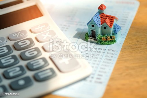 istock House model with calculator on book bank. 672450220