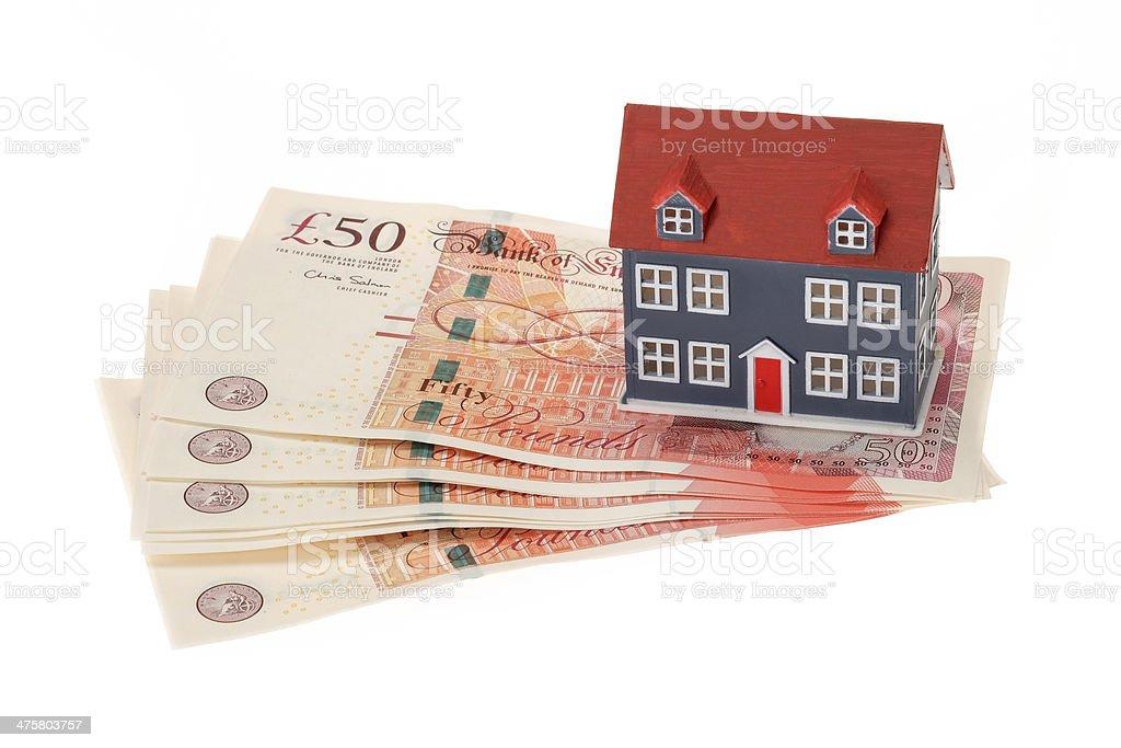 House mortgage concept image avec la monnaie britannique - Photo